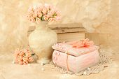 stock photo of casket  - Beautiful still life with vintage casket and flowers - JPG