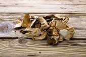 stock photo of porcini  - Dried porcini mashrooms on old wooden board