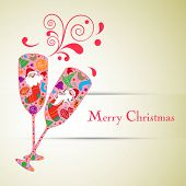 Merry Christmas celebration greeting card or invitation card with colorful floral decorated champagne glasses on abstract background,