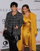 LOS ANGELES - DEC11:  Kris Jenner & Kim Kardashian arrive to Women in Entertainment Breakfast 2013