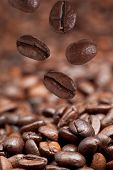 Few Falling Beans And Dark Roasted Coffee