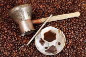 stock photo of pot roast  - top view small cup of coffee and roasted coffee beans with chocolate bars coffee pot - JPG