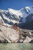 Sexy young woman near mountain lake