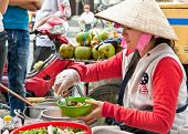 HO CHI MINH, VIETNAM-NOVEMBER 17. 2013: Street food vendor in the street of Ho Chi Minh on Noveber 1