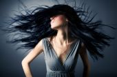 stock photo of hair motion  - Woman with fluttering hair - JPG