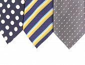 Background of three  multi-colored tie.