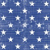 little white stars in regular horizontal and vertical rows on dark blue background grunge seamless p