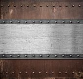 image of ironclad  - old metal plate over rusty background with rivets - JPG