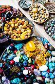Colorful Gemstones On Sale At A Flea Market In Jerusalem, Israel. Multicolored Background.