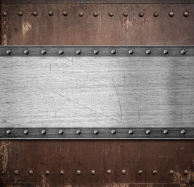 stock photo of ironclad  - old metal plate over rusty background with rivets - JPG