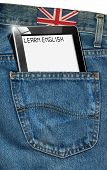 stock photo of pronunciation  - Blue jeans fabric with black tablet computer with phrase  - JPG