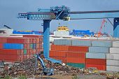Scrap metal and container in port