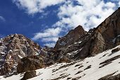 stock photo of taurus  - Rocks with snow at nice day - JPG