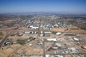 stock photo of piestewa  - Industrial Buildings cover the landscape southeast of downtown Phoenix near the Loop 202 San Tan freeway and Interstate 10 interchange