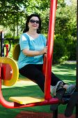 Woman Working Out A Leg Press Station Outdoor
