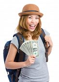 Asian female traveler holding cash