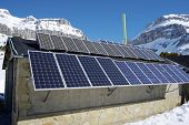 Photovoltaic panels on the roof of a hut in the Pyrenees, Aragues Valley, Aragon, Huesca, Spain.