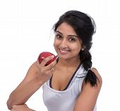 picture of indian apple  - Happy Asian female holding an apple against white background - JPG