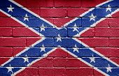 Confederate flag painted on grungy brick wall