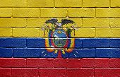 Flag of Ecuador painted onto a grunge brick wall
