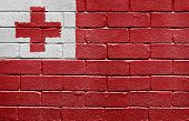 Flag of Tonga painted onto a grunge brick wall