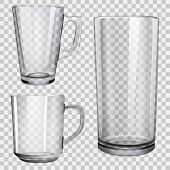 stock photo of tumbler  - Two transparent glass cups and one glass for juice - JPG