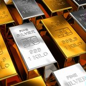 Gold and Silver Bars placed next to each other with shallow depth of field