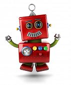 image of cyborg  - Little vintage toy robot jumping of joy over white background - JPG