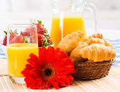 early breakfast, juice, croissants and Berries