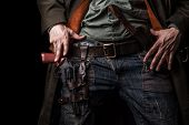 Male Hands Cowboy And Revolver On Belt