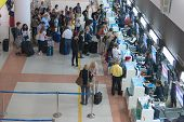 Passenger queue near check-in desks in airport