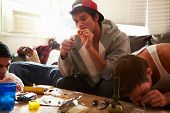 stock photo of crystal meth  - Gang Of Young Men Taking Drugs Indoors - JPG
