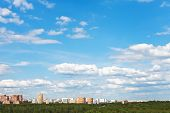 Skyline With White Clouds In Blue Sky