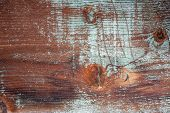 background and texture of grunge weathered barnwood with green paint remains