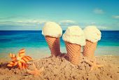 Vanilla ice creams on the beach - nostalgic retro tone effect added