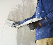 worker plastering tool plaster marble