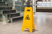 pic of slip hazard  - Yellow sign that alerts for wet floor - JPG