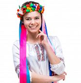 stock photo of national costume  - young happy woman in Ukrainian national costume on a white background isolated - JPG