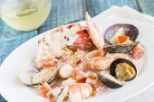stock photo of cooked crab  - Seafood stew made with lobster crab shrimp and clams cooked in coconut milk with tomatoes and onions - JPG
