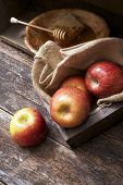 image of wooden crate  - Apples and Honey on Aged Wooden Table - JPG