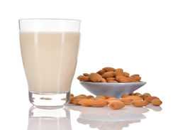 stock photo of substitutes  - Almond milk as a substitute for dairy milk - JPG