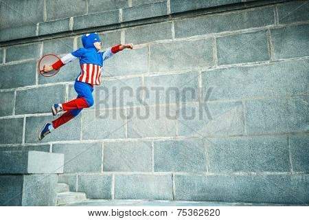 Hopping boy dressed as Captain
