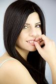 Smiling Beauty With Green Eyes And Long Black Hair Portrait
