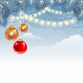 Christmas winter background with fir branches, electric garland and decorations