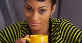 Close Up Of Sultry Black Woman Smiling With Mug