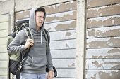 Homeless Teenage Boy On Street With Rucksack