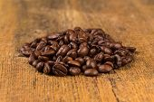 Coffee Beans On Grunge Wooden Background