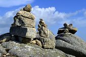 Stones balancing on top of Foil the highest mountain of Algarve, Portugal.