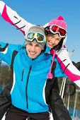 Portrait of happy couple of alps skiers have fun. Concept of winter sports and cute vacations