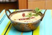 Indian, Rajasthani, Gujarati Curd Curry in a copper bowl